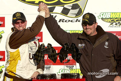 Brad Parrott, Dale Jarrett's crew chief, gets a high-five from brother and former crew chief Todd Parrott