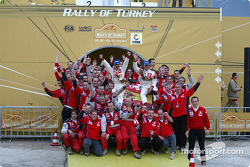 The podium: Carlos Sainz, Marc Marti and the whole team celebrate win