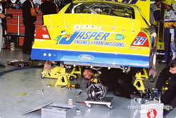 Crew works on Dave Blaney's car