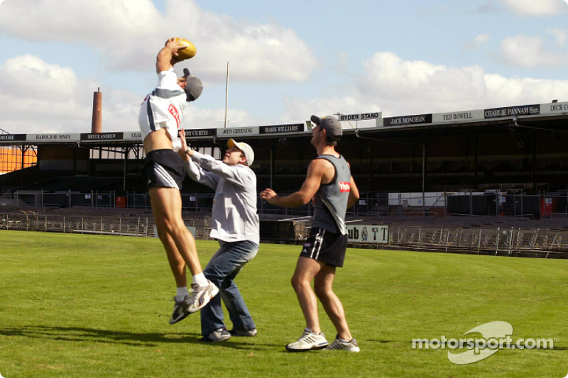 Fernando Alonso and Jarno Trulli play with Australian-rule football stars Alan Didak and Anthony Rocca