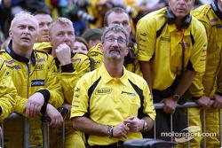 Eddie Jordan and his team celebrate Giancarlo Fisichella's second place finish