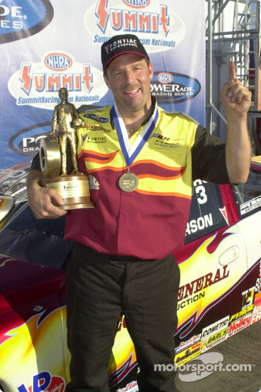 Greg Anderson proudly displays his trophy