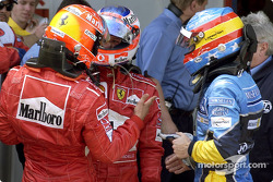 Race winner Michael Schumacher with Rubens Barrichello and Fernando Alonso