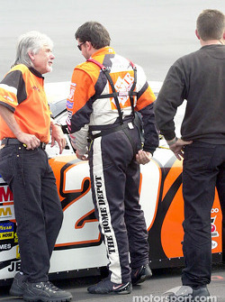 Tony Stewart adjusts his safety harness