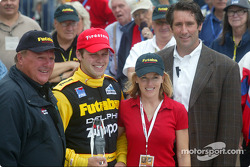 A.J. Foyt, race winner Ed Carpenter, Laura George and Tony George