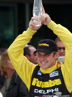 Race winner Ed Carpenter celebrates victory