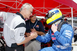 David Donohue is congratulated by a member of the Brumos Racing crew after capturing his third pole of the season
