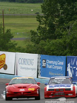#50 Michael Baughman Racing Firebird: Bob Ward, Frank DelVecchio, and #69 Marcus Motorsports BMW M3: Brian Cunningham, Hugh Plumb, Gilles Vannecet