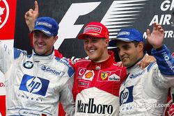 Podio ganador de la carrera Michael Schumacher, segundo lugar Ralf Schumacher y tercer lugar Juan Pablo Montoya