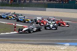 The start: Kimi Raikkonen takes the lead in front of Ralf Schumacher