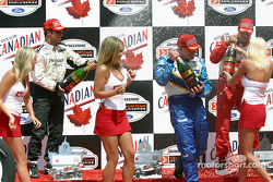 Champagne for race winner Paul Tracy, Michel Jourdain Jr. and Bruno Junqueira
