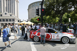 Fans check out the cars