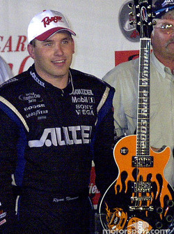 Ryan Newman with the winners guitar