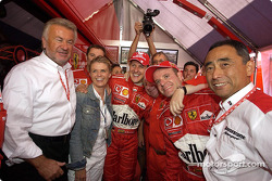 Race winner Michael Schumacher celebrate with Willi Webber, wife Corinna, Jean Todt and Rubens Barrichello