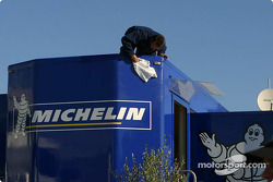 Michelin team member washes transporter