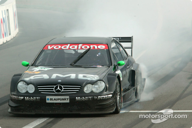 Marcel Fassler celebrates third place finish