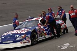 Todd Bodine's crew pushes the car