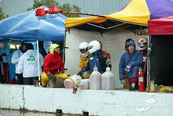 A crew prepares for its car