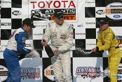 Podium: champagne for Ryan Dalziel, Kyle Krisiloff and A.J. Allmendinger
