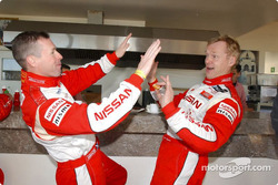 Ari Vatanen celebrates with Colin McRae