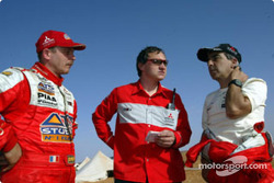 Mitsubishi Motors Motor Sports' Team Director Dominique Serieys with co-drivers Jean-Paul Cottret and Gilles Picard