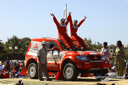 Andrea Mayer and Andreas Schulz celebrate on the finish podium