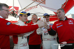 Champagne celebrations for SŽbastien Loeb, Daniel Elena, Guy FrŽquelin and Citro'n Sport team members