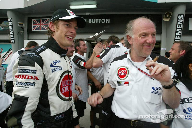 Jenson Button celebrates with David Richards