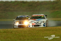 Mark Winterbottom and Cameron McConville brush at turn 3
