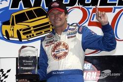Race winner Rick Crawford celebrates victory