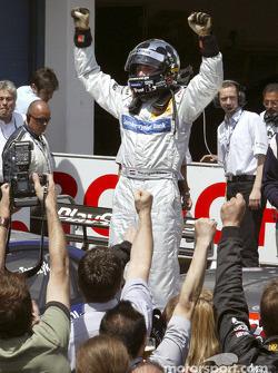 Race winner Christijan Albers celebrates