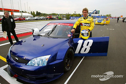 Nick Heidfeld gives a prize winner a lap of the Nurburgring in a modified Ford Mondeo