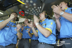 Renault F1 team members celebrate Fernando Alonso's pole position