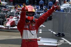 Race winner Michael Schumacher celebrates victory