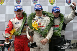 Podium: race winner Alvaro Parente with Adam Carroll and Danny Watts