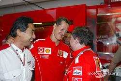 Michael Schumacher celebrates pole position with Jean Todt