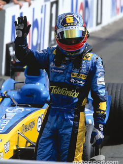 Fernando Alonso celebrates third place finish