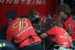 Crew works on Brandon Berstein's Top Fuel dragster