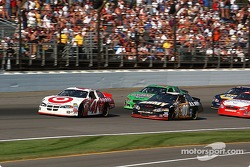 Casey Mears battles with Joe Nemecheck and Bobby Labonte for position