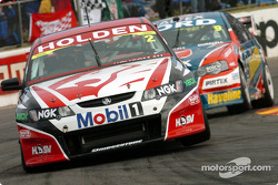Russell Ingall follows Mark Skaife onto pit straight