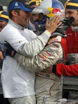 Race winner and DTM 2004 champion Mattias Ekström celebrates Martin Tomczyk
