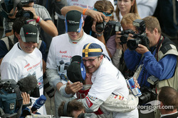 Race winner and DTM 2004 champion Mattias Ekström celebrates with Christian Abt