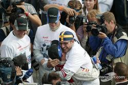 Race winner and DTM 2004 champion Mattias Ekström celebrates with Christian Abt