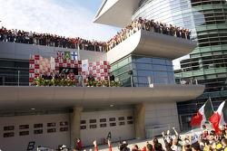 Podium: race winner Rubens Barrichello with Jenson Button and Kimi Raikkonen