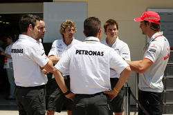 Jenson Button, McLaren Mercedes talks with his old colleagues