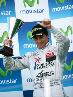 Roberto Merhi celebrates on the podium