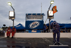 The Miller Lite crew dries off the pit stall