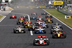 Pastor Maldonado leads the field into turn one on the opening lap of the race