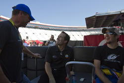 Funny car driver Ron Capps visits with Michael Waltrip and Martin Truex Jr., Michael Waltrip Racing Toyota