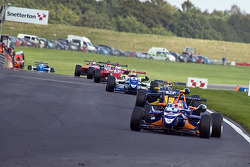 Adriano Buzaid leads in the first corner